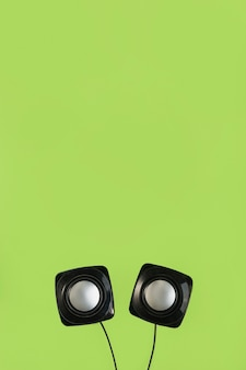 Close-up of wireless speaker on green background