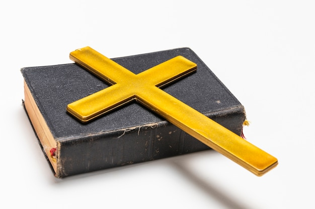Close-up with holy book and cross