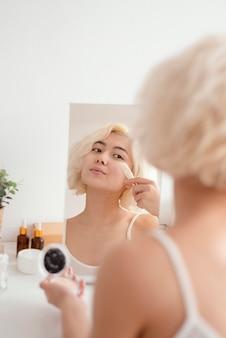 Close up woman applying powder