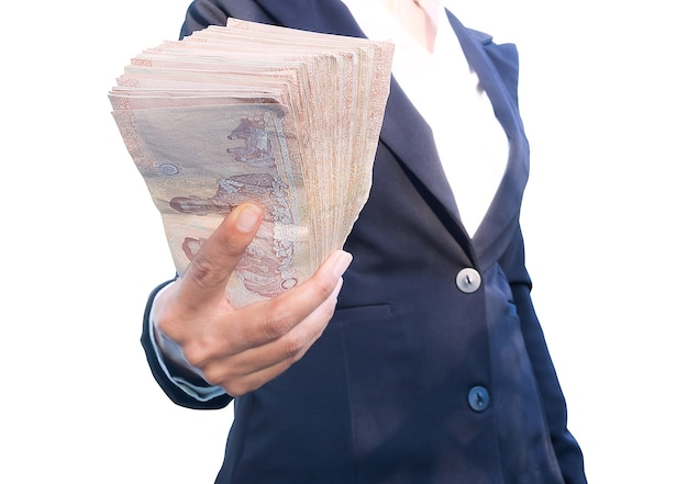 Close up woman  black suit staff holding money thai banknote of 1000 baht  isolated on white wall for business or finance contains articles about spending money.