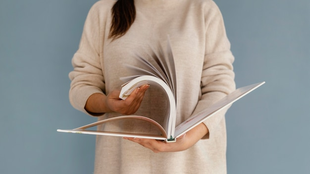 Close up woman browsing through book