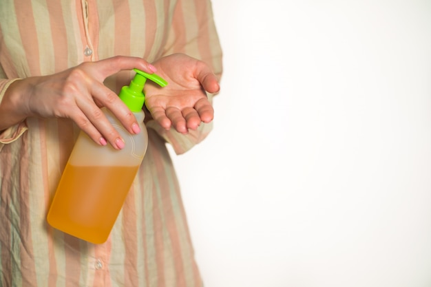 Close-up of woman bumping soap and washes hands
