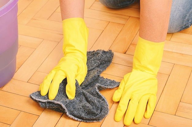 Close up of woman cleaning the floor with cloth