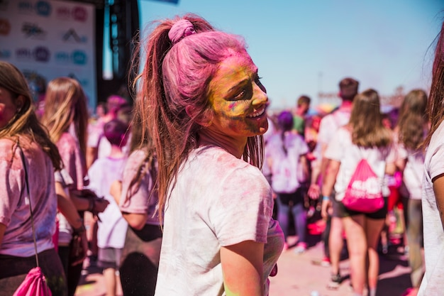 Close-up of woman covered with holi powder