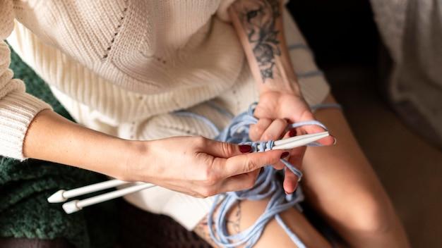 Close-up woman crocheting