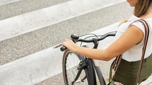 Close-up woman crossing street