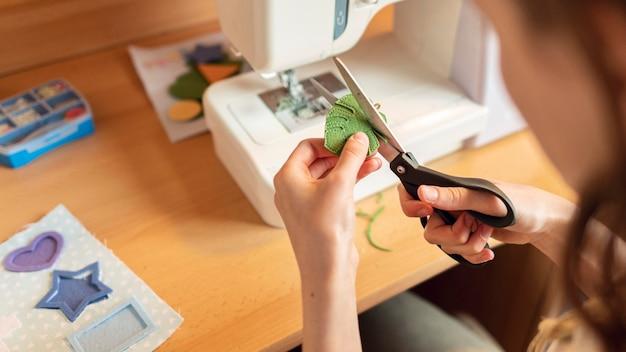 Close-up woman cutting leaf