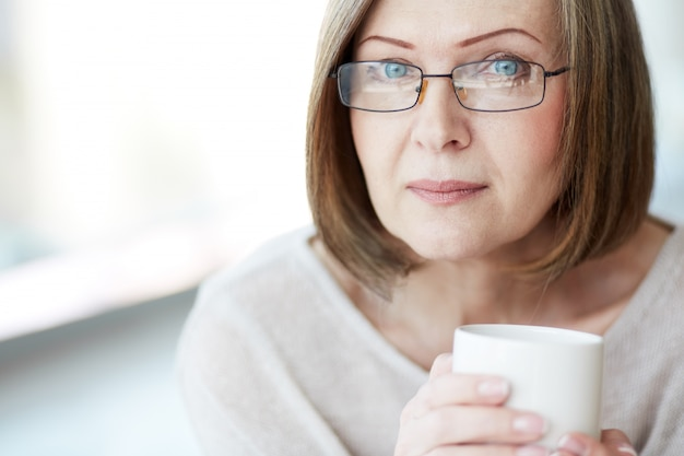 Close-up of woman drinking a hot drink