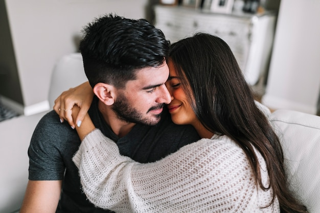Close-up of woman embracing her boyfriend