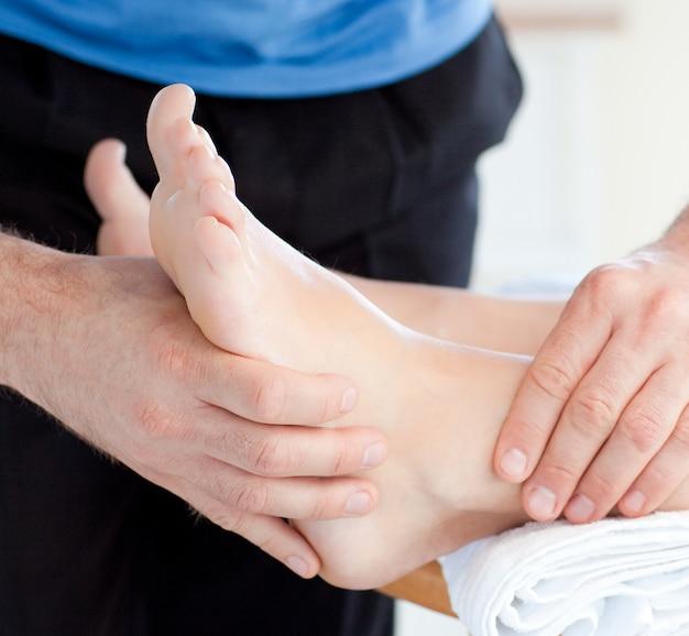 Close-up of a woman enjoying a foot massage
