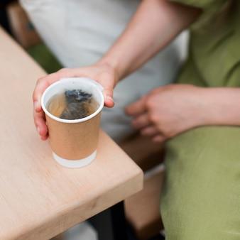 Close-up woman enjoying organic tea