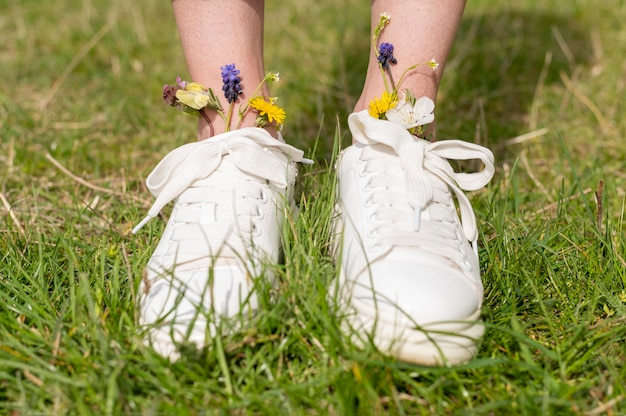Close-up woman feet with flowers