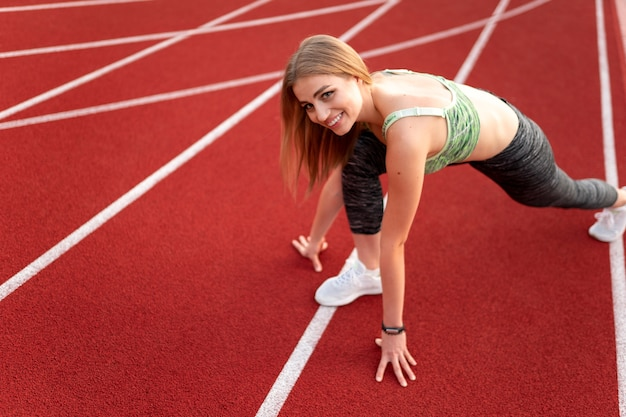 Close up on woman getting ready to run