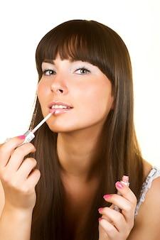 Close-up woman gloss lips