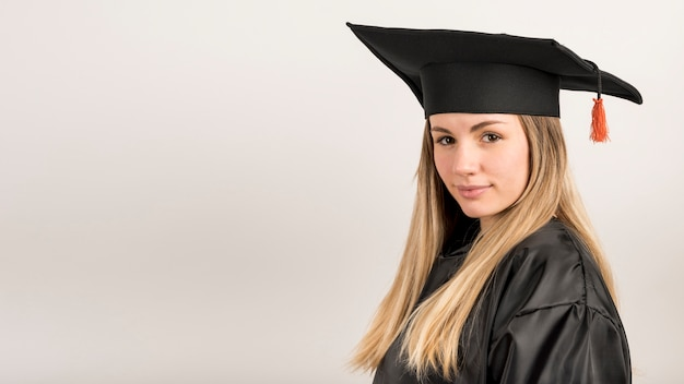 Close-up woman at graduation with copy space