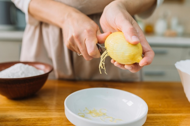 Close-up of a woman grating lemon