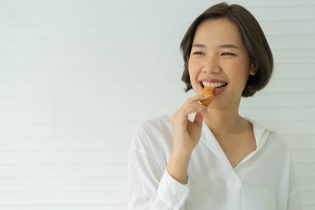Close up woman hand hold and showing fried chicken to eat for healthcare living