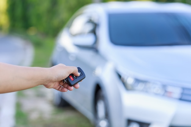 Close up woman hand holding key of new car