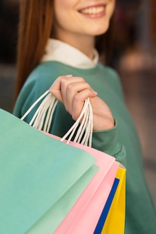 Close-up woman hand holding shopping bag