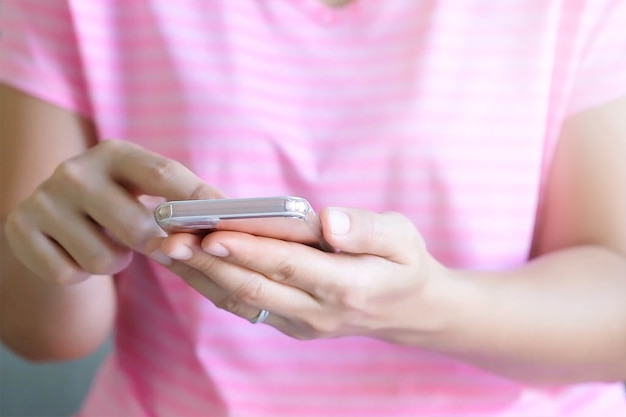 Close up woman hands holding using cell phone for online shopping