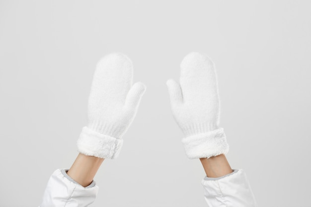 Close up woman hands up with gloves