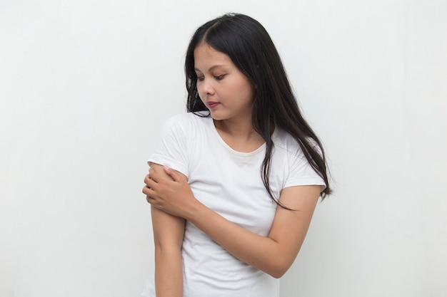 Close up woman having pain in injured elbow Premium Photo