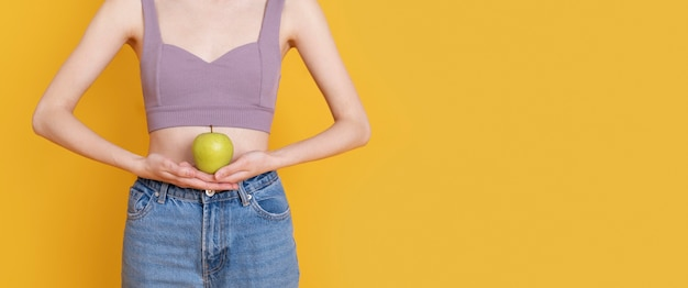 Close up woman holding apple