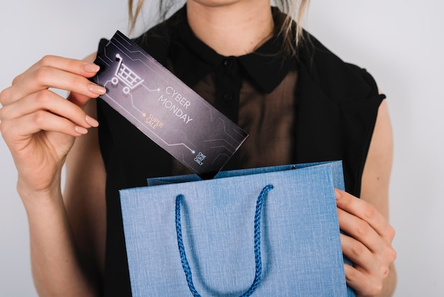 Close-up woman holding bag with cyber monday shoppings