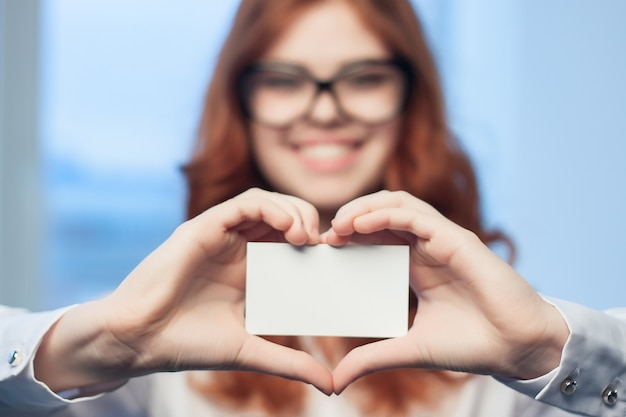 Close up on woman holding blank business card