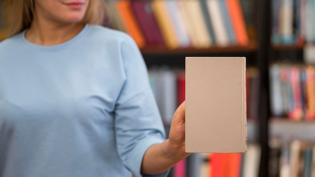 Close-up woman holding book