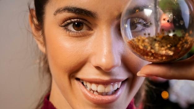 Close-up woman holding christmas globe