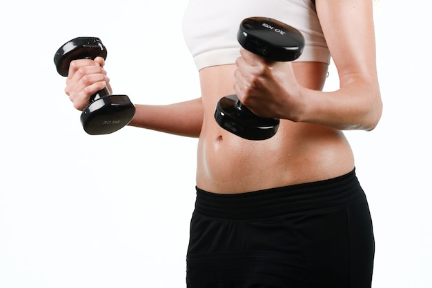 Close-up of woman holding dumbbells