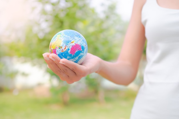Close up woman holding earth. environmental conservation earth day concept.