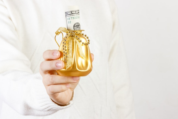 Close-up of a woman holding gift box of dollar