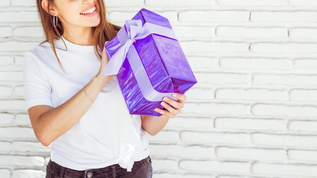 Close-up of a woman holding gift box