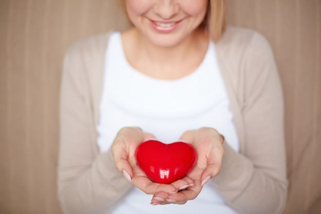 Close-up of woman holding a heart
