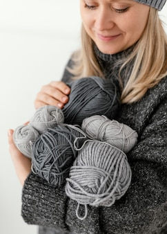 Close-up woman holding knitting yarns