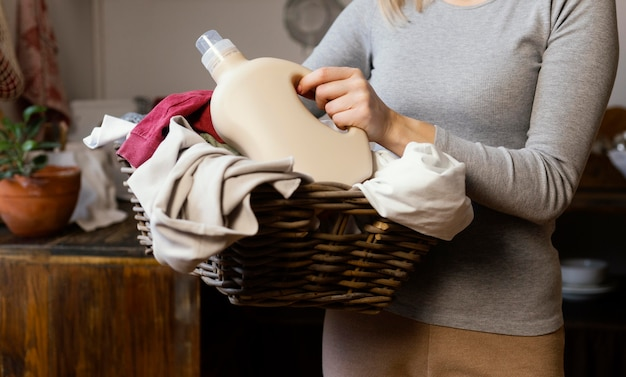 Close up woman holding laundry basket