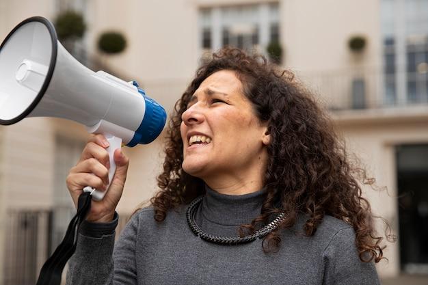 Close up woman holding megaphone