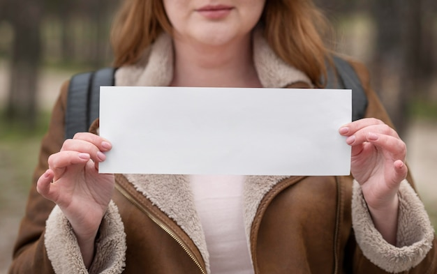 Close up woman holding paper piece