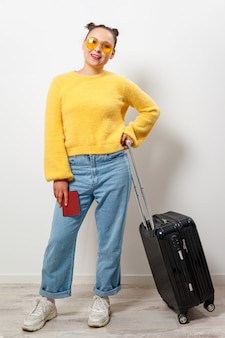 Close-up woman holding a passport and travel bag in her hands. travel, immigration, emigration concept