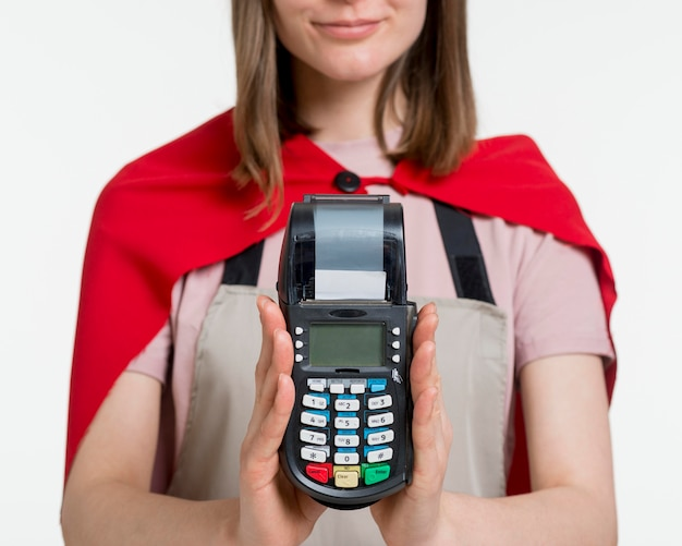 Close-up woman holding pos machine