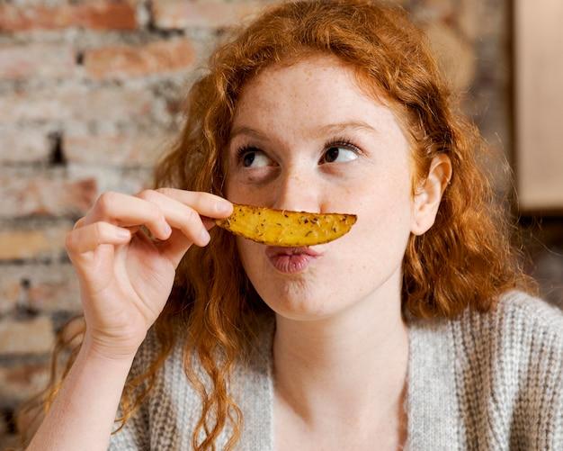 Close up woman holding potato