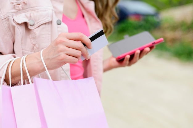Close-up woman holding shopping bags