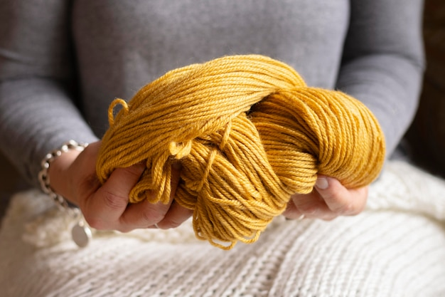 Close-up woman holding wool