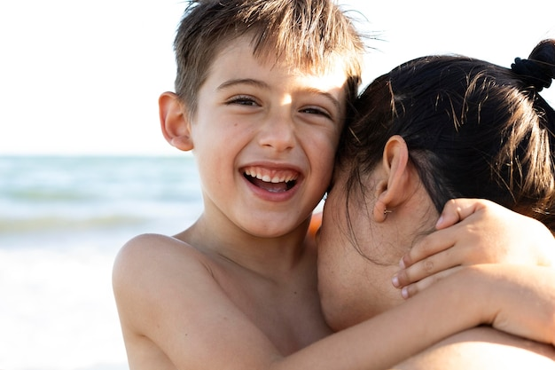 Close up woman kissing kid