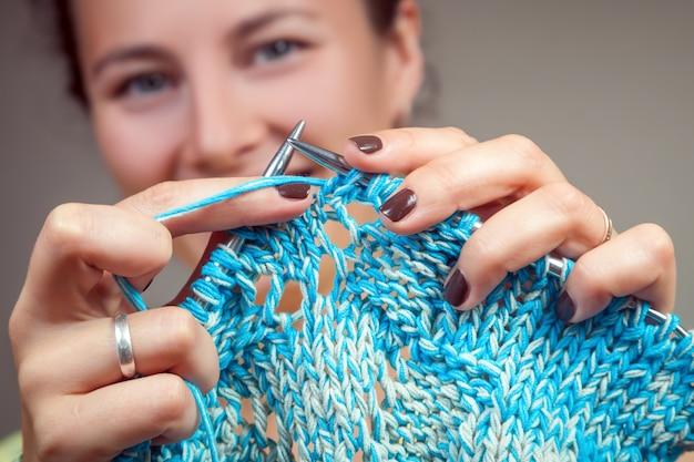 Close up of woman knitting