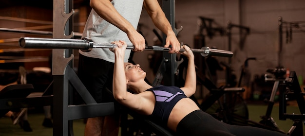 Close-up woman lifting bar
