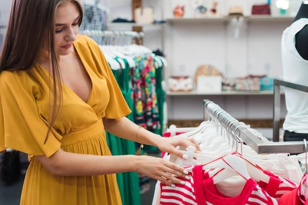 Close-up woman looking at clothes