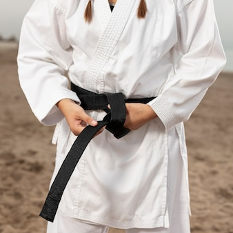 Close-up woman in martial arts costume